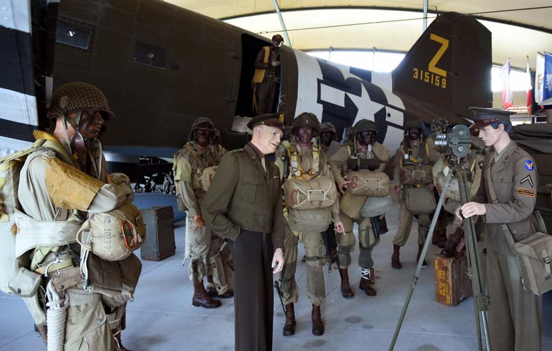 Ike talks to the press, Airborne Museum, Ste Mere Eglise, Normandy, 6 June 2019.  Berhind is USAAF Douglas C-47A Skytrain 42-100825 as D8-Z / 315159 The Argonia.