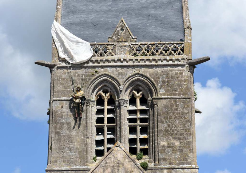 Ste Mere Eglise church, Normandy, 6 June 2019 1.  Recalling a famous incident whan a US paratrooper's paracbute snagged on the church tower.  He was eventually taken prisoner, escaped and survived.