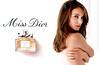 Miss DIOR Chérie Eau de Parfum 2011 Spain spread 'Miss Dior - www missdior com'<br /> ('Miss Dior Chérie Eau de Parfum' on the bottle label)