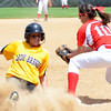 Cory Byknish/Herald<br /> Big Reds Noelle Murray attempts a tag on Iroquiois Rachel Prathner after she stole 2nd base.