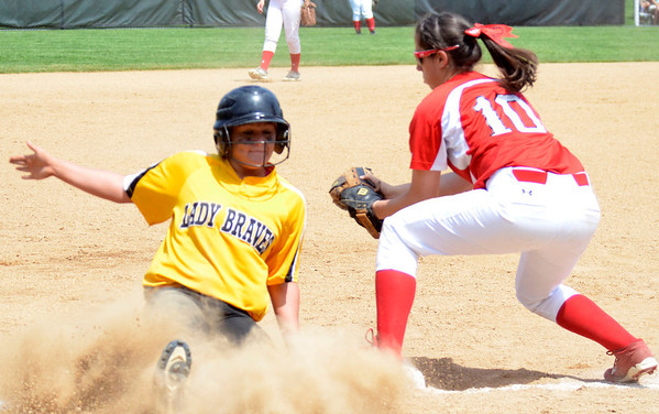 Cory Byknish/Herald Big Reds Noelle Murray attempts a tag on Iroquiois Rachel Prathner after she stole 2nd base.