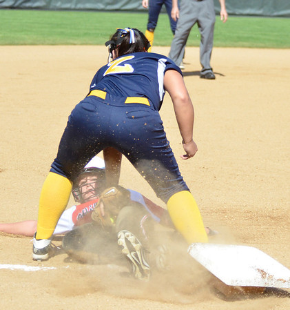 Cory Byknish/Herald                                <br /> Wilmingtons Lexi Donti tries to make an out with a North Westren steal to 3rd.