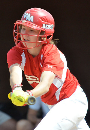 Cory Byknish/Herald<br /> Middlesexs Hannah Havens bunts the ball.