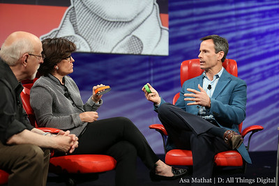 Kara Swisher and Tom Staggs hold up the Disney MagicBand.