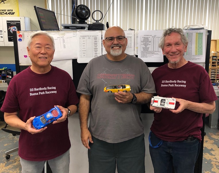 """Mixed"" race, ""Racer Handicap"" podium, L-R, Keith Tanaka 2nd (GTR), Richard Rodriguez 1st (Foreign Production Sport), Eddie Shorer 3rd (Can Am)."