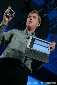 Jeff Hawkins holds up his Treo and his Foleo mobile companion