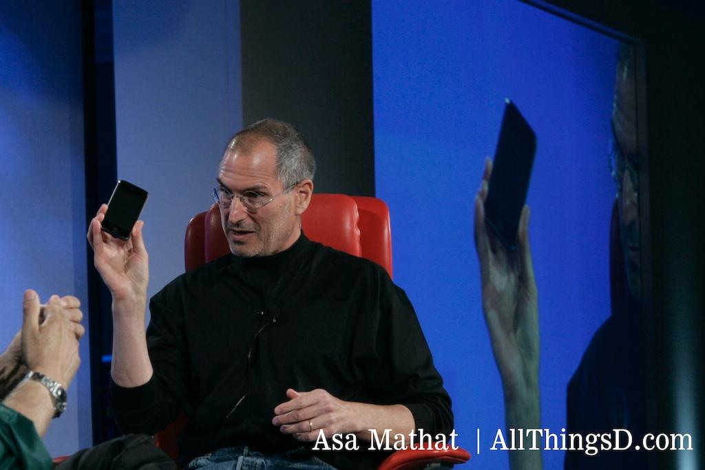 Steve holds up an iPhone