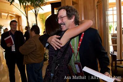 Rick Smolan hugs a D6 attendee.