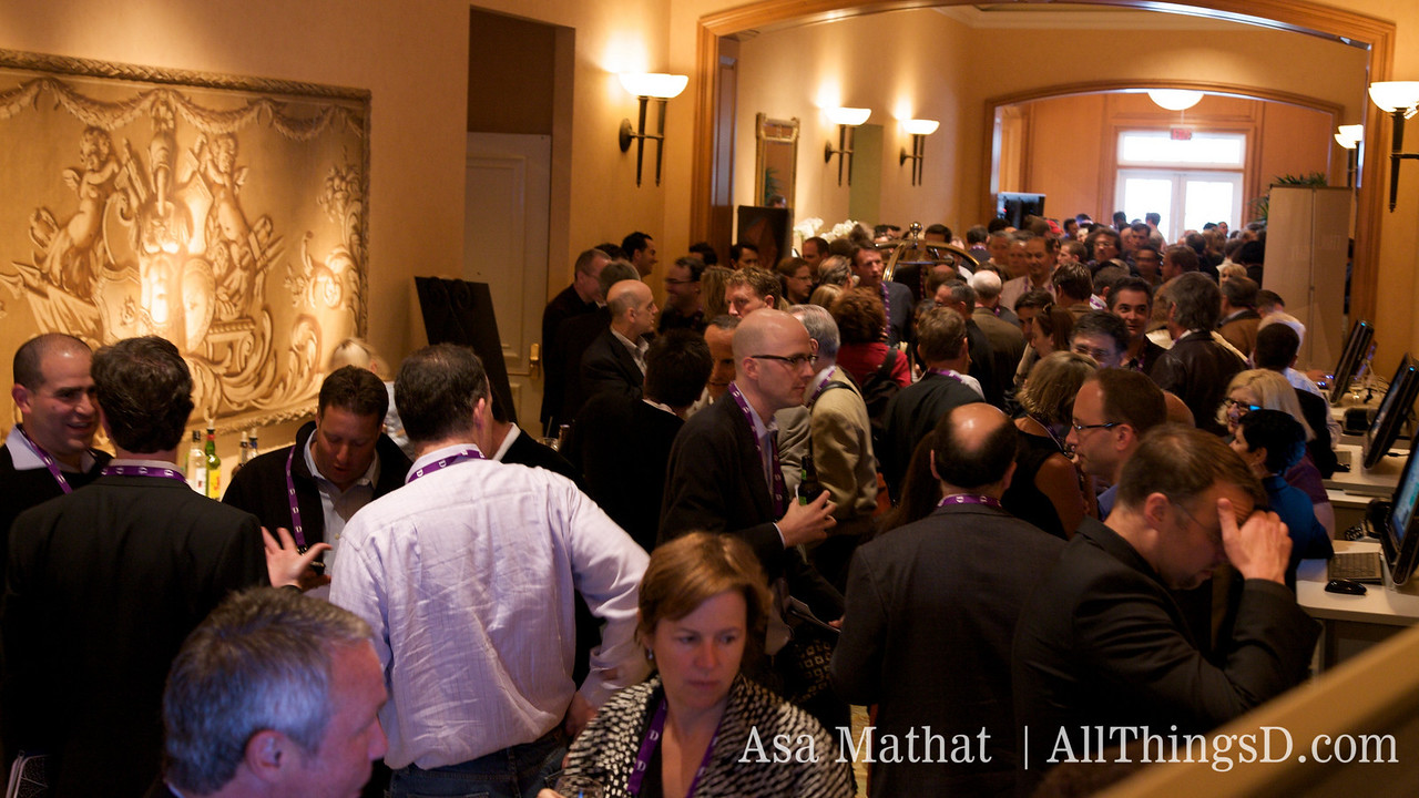 A crowd gathers for the Opening Cocktail Party.