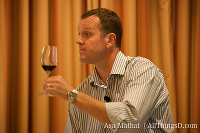 Demonstrating the to-do's of wine tasting.