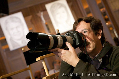 Rick Smolan takes a photograph during Jeff Zucker's session.