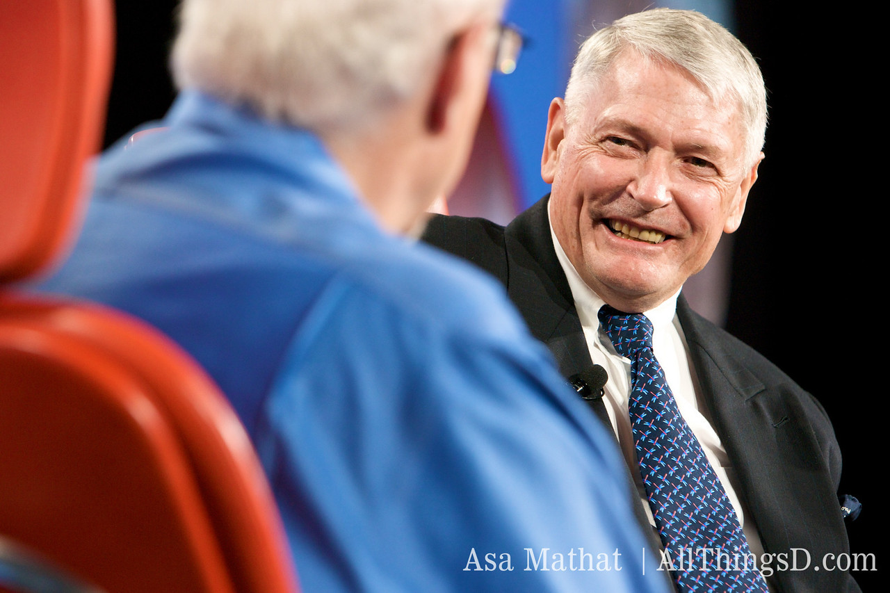 John Malone laughs on-stage during his session with Walt Mossberg.