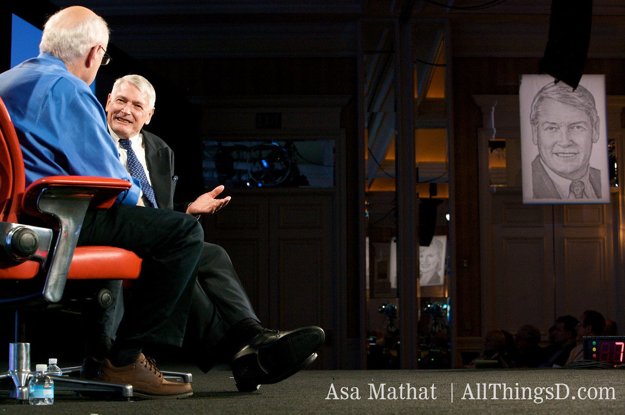 John Malone, chairman of Liberty Media, onstage and off.