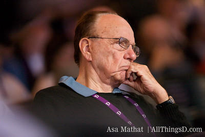 Rupert Murdoch of News Corp. listens to Randall Stephenson.