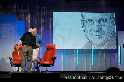 Walt Mossberg greets Microsoft CEO Steve Ballmer to the D7 stage.