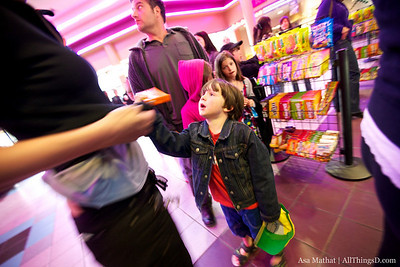 Please, mom? In line for movie candy & goodies.