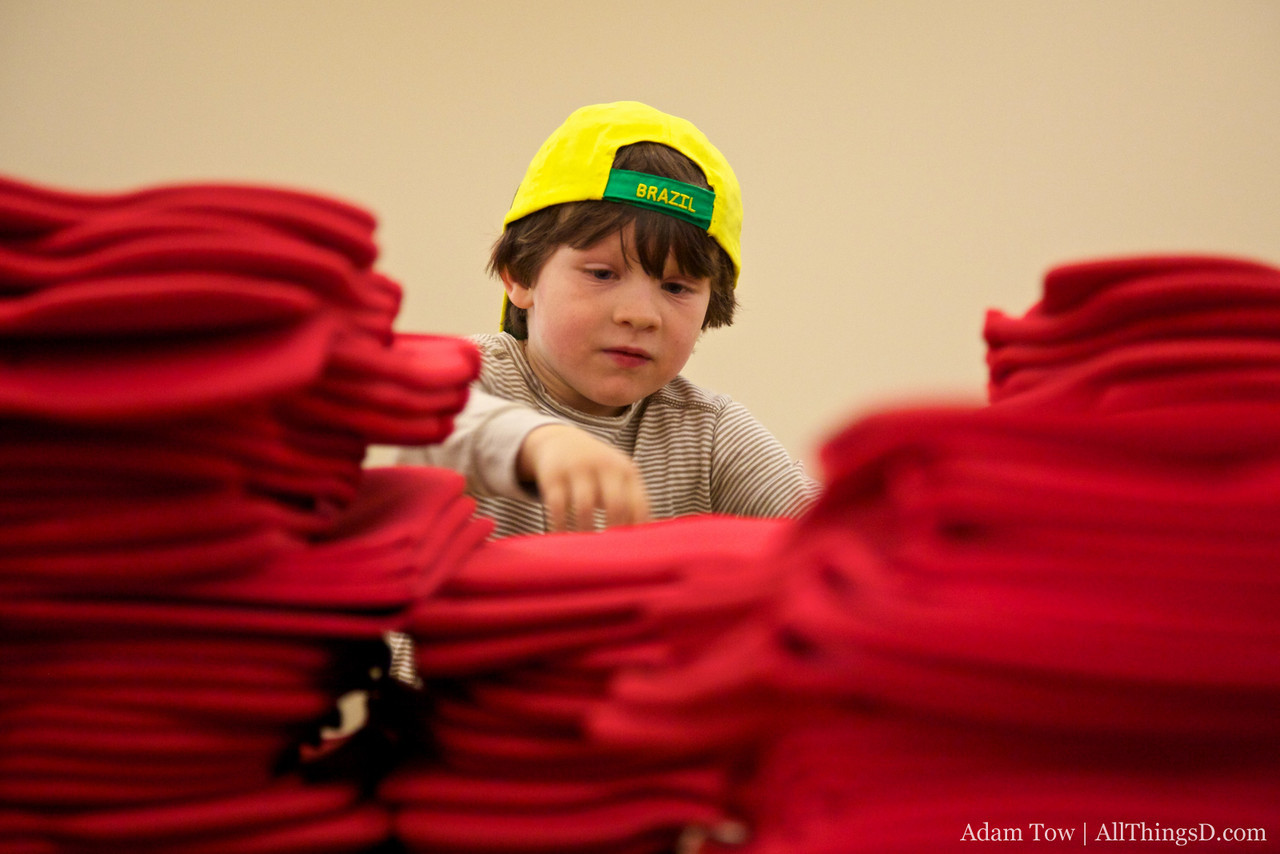 Alex pitches in to help assemble D8 swag bags.