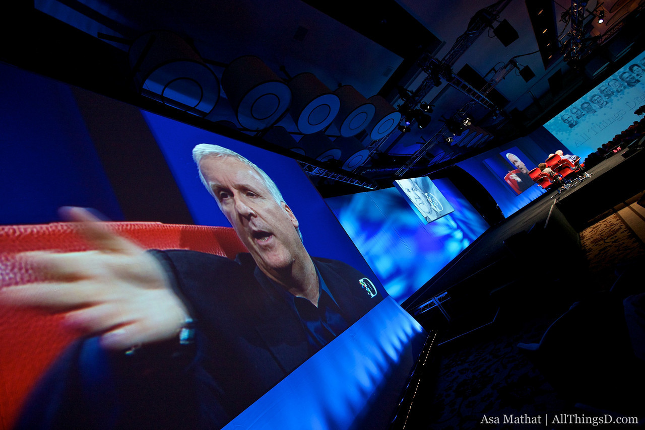 James Cameron waves his hand during his session at D8.