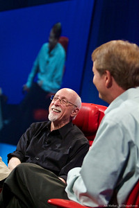 Walt Mossberg laughs during his interview session with John Donahoe.