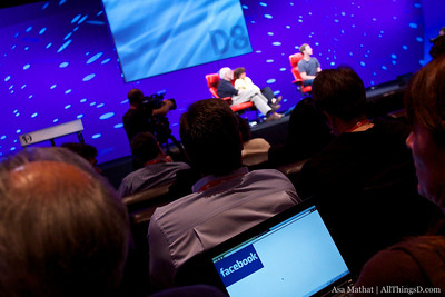 Facebook on a laptop, CEO onstage.
