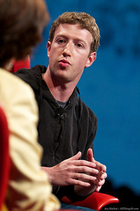 Wearing (for now) his familiar hoodie, Mark Zuckerberg answers questions from Walt Mossberg and Kara Swisher.