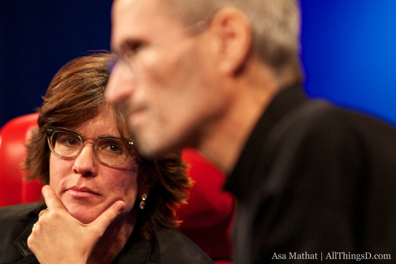 Kara Swisher listens to Steve Jobs during the questions and answers section.