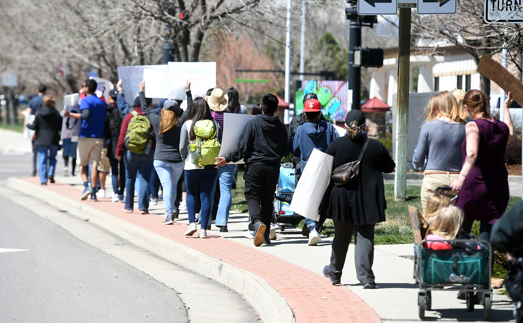 . About 2 dozen people marched from the Lafayette Municipal building to Waneka Lake to support DACA on Saturday. A group of 7 seventh graders and 4 University of Colorado undergraduates, who work with Public Achievement, marched in Lafayette to promote DACA. For more photos and a video, go to dailycamera.com. Cliff Grassmick  Photographer  April 14, 2018
