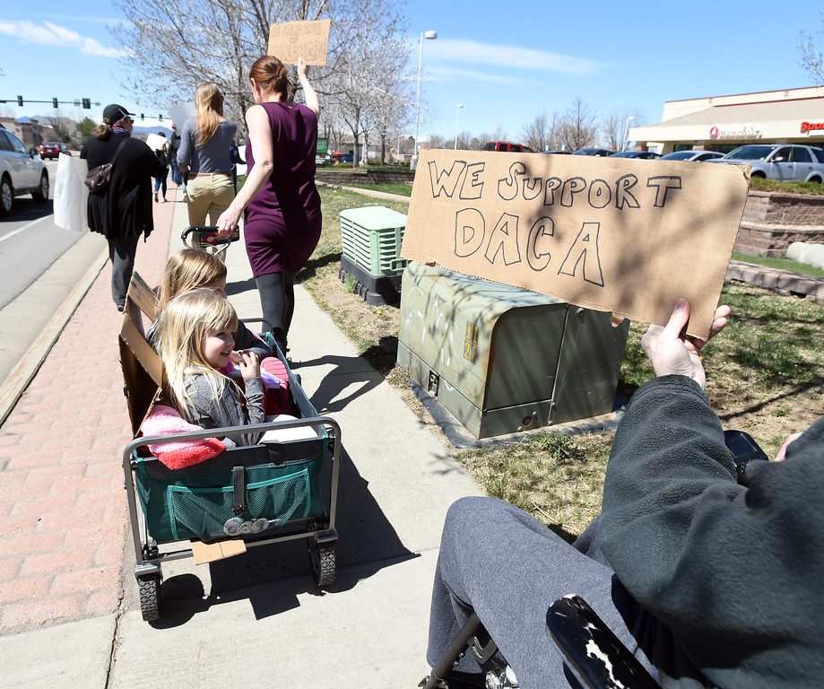 . Rachel Daly, her daughters Ammy and Kate, and Kim Williford, right, marched down S Boulder Road to support DACA. About 2 dozen people marched from the Lafayette Municipal building to Waneka Lake to support DACA on Saturday. A group of 7 seventh graders and 4 University of Colorado undergraduates, who work with Public Achievement, marched in Lafayette to promote DACA. For more photos and a video, go to dailycamera.com. Cliff Grassmick  Photographer  April 14, 2018