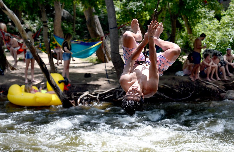 Travis Hitt, of Broomfield, does a backflip off a rope swing into the Boulder Creek on Tuesday while trying to cool off from the hot weather.<br /> Jeremy Papasso/ Staff Photographer<br /> 06/05/2018