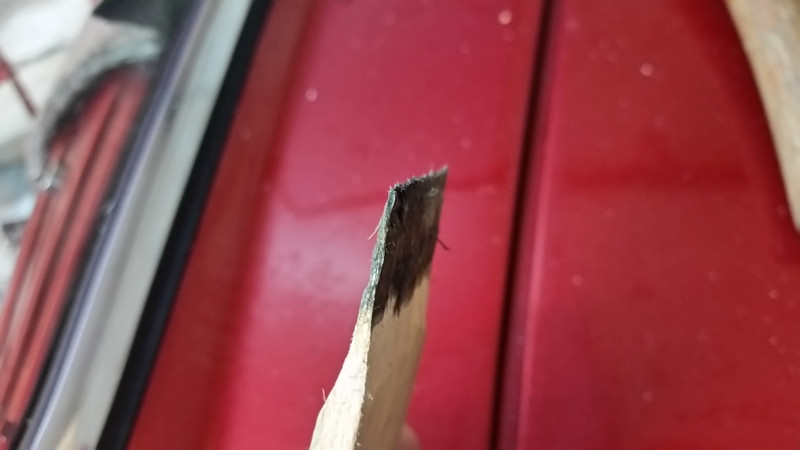 "You can make a ""helper"" with a piece of shim material for adjusting residential doors or cut off about 6"" of a yardstick. Shave it down so it can be hammered into the seal at the top to force the seal material into the upper edge of the windshield framing."