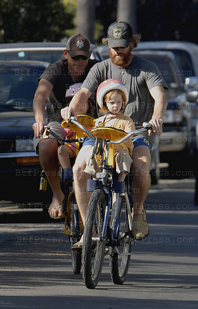 DANNY MODER AND FRIEND TAKE THE KIDS OUT FOR A BIKE RIDE NEAR DANNY AND JULIA'S HOME IN VENICE, CALIFORNIA. DANNY SEEMS TO LIKE THE SCRUFFY LOOK - WONDER HOW JULIA LIKES IT?(THE CHILD ON DANNY'S BIKE IS ONE OF THE TWINS- NOT CERTAIN WHICH / WHOSE CHILD IS ON DANNY'S FRIEND'S BIKE.