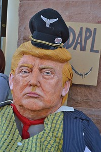 Protesters who gathered at a Wells Fargo branch in Boulder, Co to protest the banks connection to the Dakota Access Pipeline, brought along this puppet of President-Elect Donald Trump. Trump has vowed to complete the disputed pipeline.