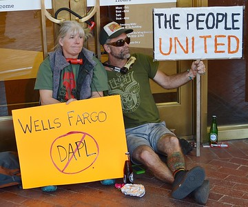 Denise Littrell and George Ridgik locked themselves to the entrance of a Wells Fargo branch in Boulder, Co to protest the banks connection to the Dakota Access Pipeline.
