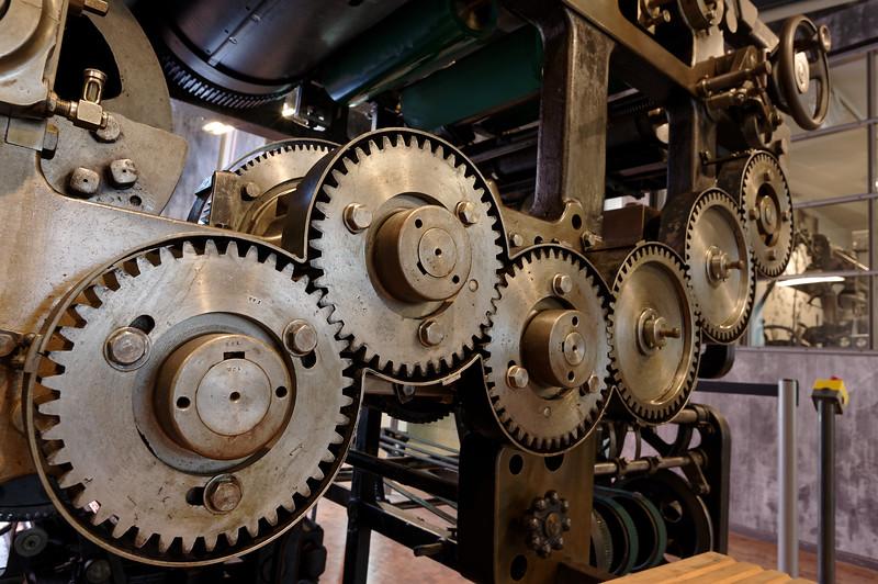 Gears of a newspaper printing press