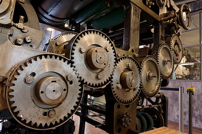 Gears of a newspaper printing press