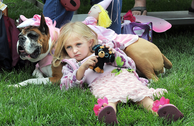 Hannah Craig, 5, rests on her dog Melody before competing in the Best Dressed Dog Contest during Broomfield Days at Midway park on Saturday.<br /> September 17, 2011<br /> staff photo/ David R. Jennings