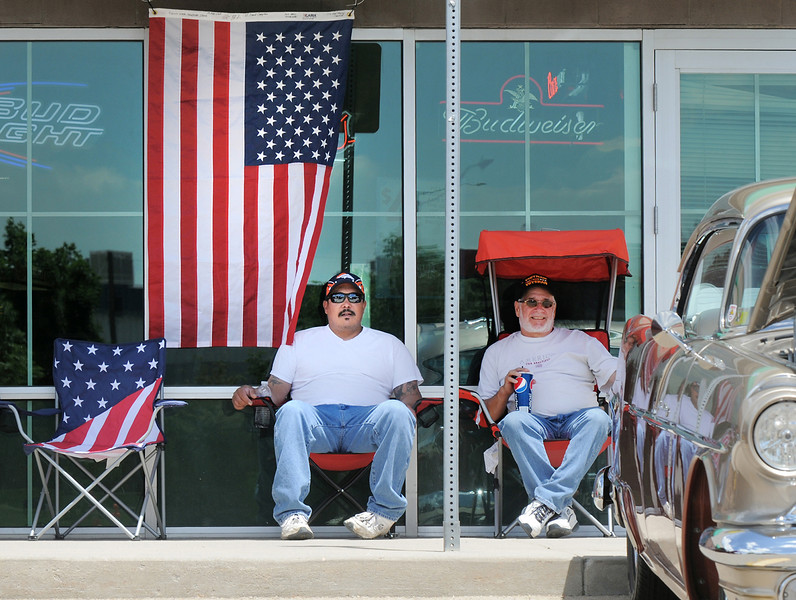 Ryan and Mike Castro keep watch over their car  in the One Soldier's Dream car show fundraiser for at Bumpers Restaurant. <br /> June 18, 2011<br /> staff photo/David R. Jennings