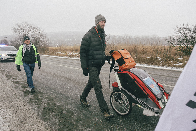 Jan (Poland) marching with all his belonging and the march backpack. This time the group was secured by the police.