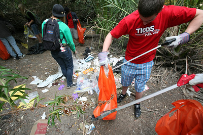SAN DIEGO, CA - DiscoveryBound youth clean up the shores of the San Diego river as a fundraiser to raise money for an adventure trip to Hawaii.