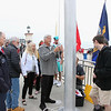 OCEAN CITY, NJ - MAY 31, 2021 - Ocean City held their Memorial Day Flag Raising Ceremony at the Music Pier, Monday morning at 8:50 AM. The flag raising will be at the same location and time thru September 11, 2021.<br /> Ocean City Aide to the Mayor, Mike Allegretto, Jess Caserta and Mike Caserta prepares to raise the flag. (Donald Kravitz)