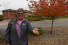 """Lucinda Mays holds an apple from a Brandywine crabapple (Malus x """"Branzam"""") planted near Old Admin at Chadron State College. (Photo by Daniel Binkard/Chadron State College)"""
