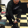 Gary Mays showing the children how he ties his shoes with only one hand.