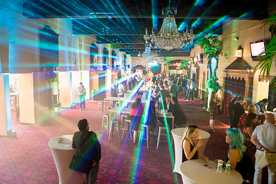 The only thing that can make an open bar happy hour better is a laser show at an open bar happy hour.