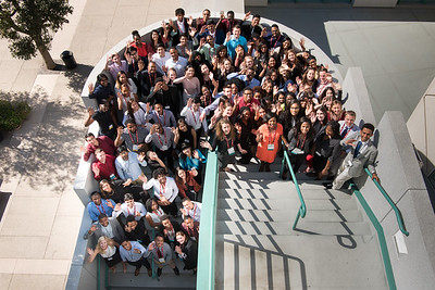 Young adults pose for a photo outside of FIDM after a workshop in Los Angeles, California.