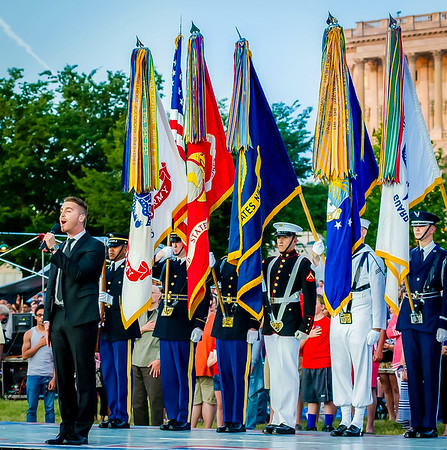 American Idol winner Nick Fradiani sings the National Anthem to kick of the National Memorial Day Concert outside of the Capitol on the National Mall.