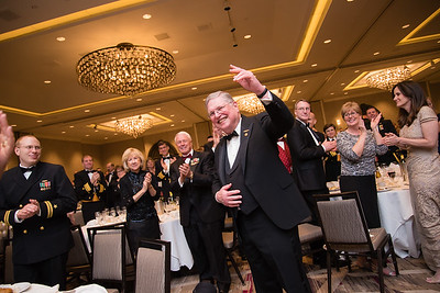Father of Admiral John M. Richardson stands to be recognized for his service at the Submarine Birthday Ball in Crystal City.
