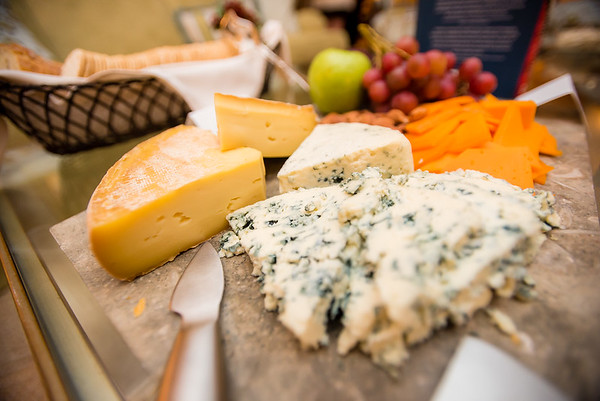 Cheese, grapes, and crackers make socializing all that much more fun at an author book signing party.