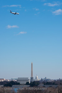 US Air Express over DC Memorials