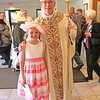 "YOUNGEST MEMBER OF THE DCCW—Bishop Edward M. Rice at the annual DCCW Spring Assembly with Alyssa Jurgens, age 10, of St. Vincent de Paul Parish in Cape Girardeau. ""You must be the youngest member of the DCCW!"" Bp. Rice said to Jurgens. (Photo by J.B. Kelly/<i>The Mirror</i>)"