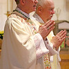 "Bishop Edward Rice celebrated Mass along with several other diocesan clergy the evening of Friday, April 20, for DCCW Spring Assembly attendees. ""For 60 years,"" Bishop told the ladies, ""you've been the backbone of our parishes, doing the great and small works that have helped this diocese become what it is today."" (Photo by J.B. Kelly/<i>The Mirror</i>)"